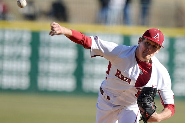 Arkansas pitcher Ryne Stanek fires a pitch in the first inning of Friday afternoon's season opener against Western Illinois at Baum Stadium in Fayetteville.