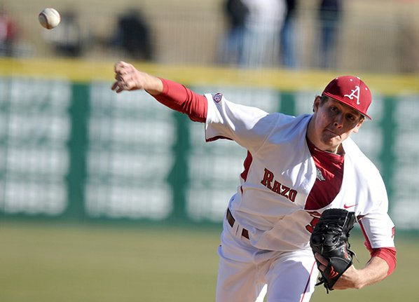 Arkansas pitcher Ryne Stanek fires ...