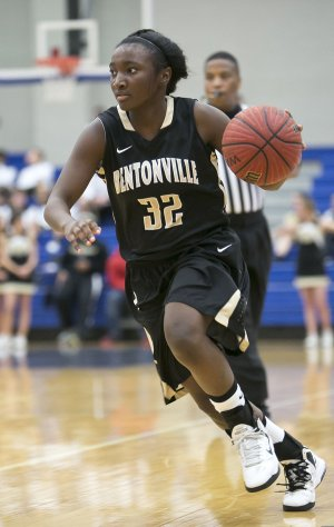 Jamayne Potts of Bentonville brings the ball up the court during Tuesday's game against Rogers at Rogers High.