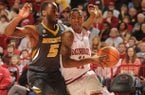 Arkansas sophomore guard BJ Young, right, drives along the baseline as Missouri senior Keion Bell defends Saturday in Bud Walton Arena in Fayetteville. Young scored 18 points, including seven points in the final 29 seconds, as the Razorbacks beat Missouri 73-71.