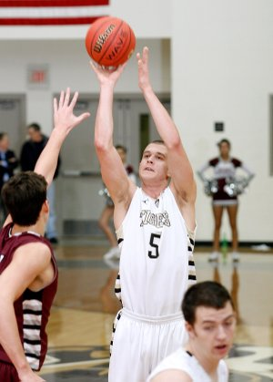 Nick Smith, a Bentonville senior, puts up a shot over Siloam Springs senior Payton Henson during the first half on Friday at Bentonville.