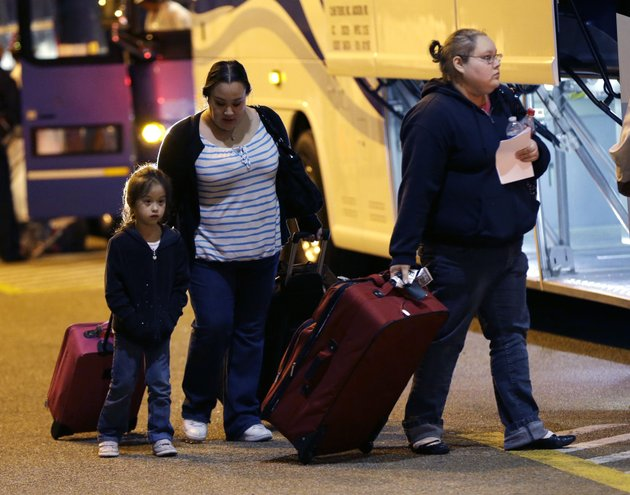 passengers-from-the-disabled-carnival-triumph-cruise-ship-arrive-by-bus-at-the-hilton-riverside-hotel-in-new-orleans-friday-feb-15-2013-the-ship-had-been-idled-for-nearly-a-week-in-the-gulf-of-mexico-following-an-engine-room-fire