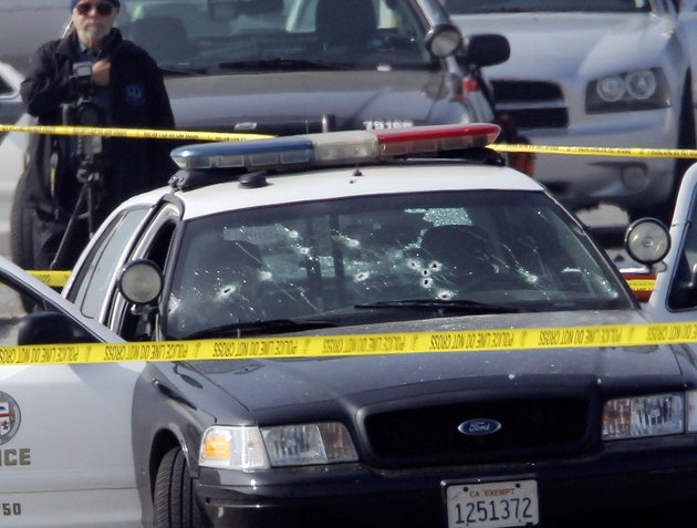 file-this-feb-7-2013-file-photo-shows-a-bullet-damaged-los-angeles-police-vehicle-in-corona-calif-after-suspect-former-los-angeles-police-officer-christopher-dorner-shot-at-two-lapd-officers-in-the-vehicle-who-were-sent-to-corona-to-protect-someone-dorner-threatened-in-a-rambling-online-manifesto