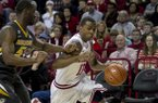 Arkansas guard BJ Young (11) drives to the basket against Missouri's Keion Bell (5) during the Razorbacks' 73-71 win over Missouri. Young scored 18 points, including seven in the final 29 seconds. (AP Photo/Gareth Patterson)
