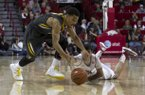 Missouri's Phil Pressey (1) loses the ball as he is guarded by Arkansas captain Kikko Haydar, right, during the second half an NCAA college basketball game in Fayetteville, Ark., Saturday, Feb. 16, 2013. Arkansas defeated Missouri 73-71. (AP Photo/Gareth Patterson)