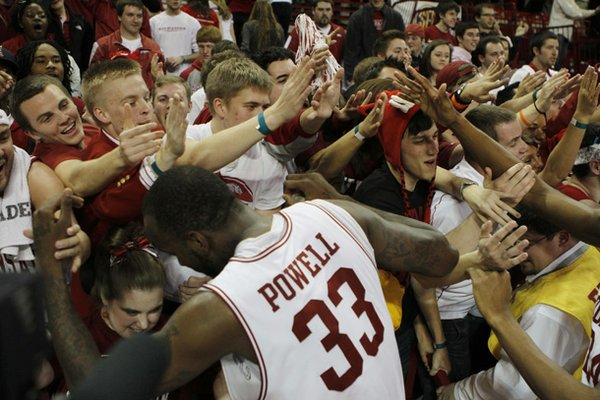 Arkansas forward Marshawn Powell celebrates with the student section following Arkansas' 73-71 win over Missouri. (AP Photo/Gareth Patterson)