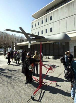 A model of a military-style drone sits Thursday outside the Alameda County Administration Building in Oakland, Calif., before a hearing on the county sheriff's plan to acquire a drone for aerial surveillance.