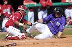 Arkansas catcher Jean Ramirez tries to tag out Western Illinois base runner Erik Maki during the fourth inning of Sunday afternoon's game at Baum Stadium in Fayetteville. Maki scored on the play.