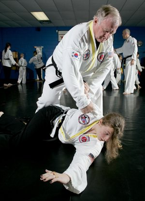 Jackson practices defense drills with black belt Savannah Barnes, 13, in class Tuesday morning at Northwest Taekwon-Do.