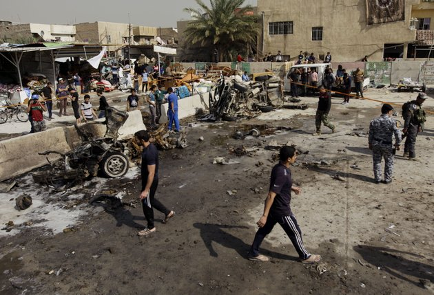 iraqis-inspect-the-scene-of-a-car-bomb-attack-in-the-ameen-neighborhood-in-eastern-baghdad-iraq-sunday-feb-17-2013-a-series-of-car-bombs-exploded-within-minutes-of-each-other-as-iraqis-were-out-shopping-in-and-around-baghdad-on-sunday-killing-and-wounding-scores-of-people-police-said