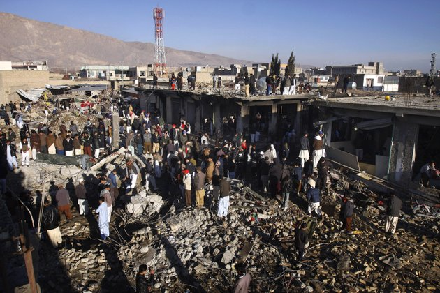 local-residents-survey-a-damaged-market-caused-by-saturdays-bombing-in-quetta-pakistan-on-sunday-feb-17-2013-the-death-toll-from-the-horrific-bombing-that-tore-through-the-crowded-vegetable-market-in-a-mostly-shiite-muslim-neighborhood-of-southwestern-pakistan-climbed-to-81-with-many-of-the-severely-wounded-dying-overnight-a-pakistani-police-official-said-sunday