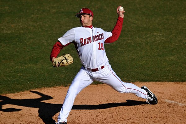Arkansas freshman Colin Poche delivers a pitch during the Razorbacks' 14-0 win over New Orleans in the first game of a doubleheader Tuesday at Baum Stadium in Fayetteville.