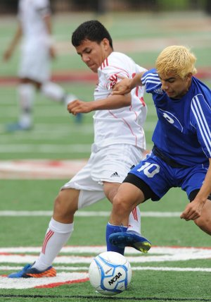 Danny Garcia, Rogers High defender, collects the ball May 11 at Northside High School in Fort Smith.