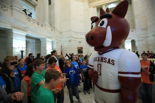 Sixth graders from Rose Bud Elementary gather around the Razorback mascot Tuesday afternoon during Razorback Day at the Capitol.