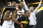 Missouri's Tony Criswell, left, Alex Oriakhi, center, and Corey Haith, bottom, right, celebrate after the Missouri defeated Florida 63-60 in an NCAA college basketball game Tuesday, Feb. 19, 2013, in Columbia, Mo. (AP Photo/L.G. Patterson)