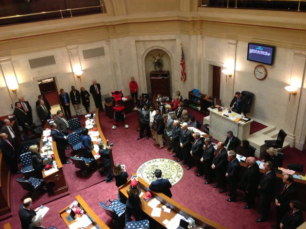 members-of-the-arkansas-state-football-team-and-officials-from-the-school-stand-before-the-arkansas-state-senate-to-be-honored-for-their-2012-football-season-on-wednesday-at-the-state-capital-the-red-wolves-went-10-3-and-won-the-godaddycom-bowl-17-13-over-no-25-ranked-kent-state
