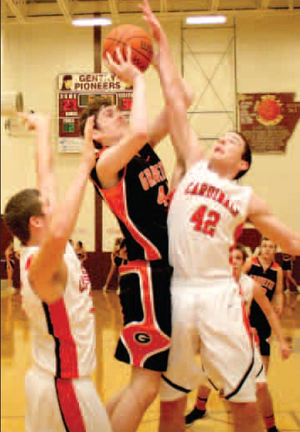 Gravette junior center Otto Troutner attempts two under the basket but is blocked by Farmington during semifinals play in Gentry on Friday.