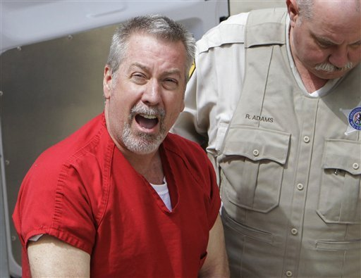 in-this-may-8-2009-file-photo-former-bolingbrook-ill-police-sergeant-drew-peterson-arrives-at-the-will-county-courthouse-in-joliet-ill-for-his-arraignment-on-charges-of-first-degree-murder-in-the-2004-death-of-his-third-wife-kathleen-savio-on-thursday-feb-21-2013-will-county-judge-edward-burmila-sentenced-peterson-to-38-years-in-prison-for-savios-murder