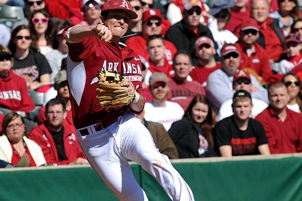 Arkansas infielder Willie Schwanke makes a play to throw out a Western Illinois runner in the second inning of Sunday afternoon's game at Baum Stadium in Fayetteville.