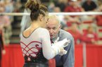 Arkansas co-head coach Mark Cook speaks to senior Amy Borsellino before her performance on the bars during a meet with Georgia Friday, Jan. 11, 2013, in Barnhil Arena on the UA campus in Fayetteville.