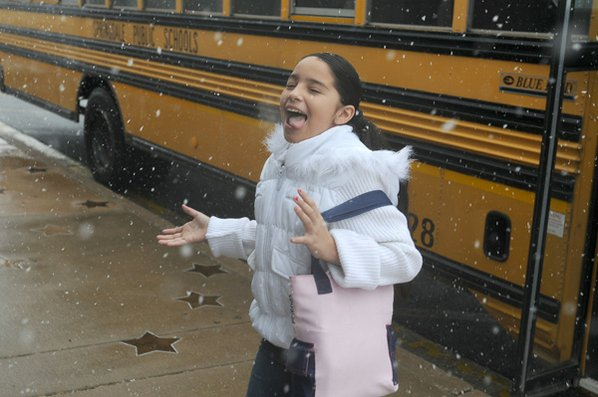 Ashley Munoz, 10, catches snowflakes ...