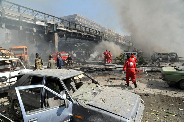 this-photo-released-by-the-syrian-official-news-agency-sana-shows-first-responders-working-after-a-huge-explosion-that-shook-central-damascus-syria-on-thursday-feb-21-2013