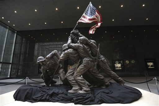 the-original-12-12-foot-4-meter-cast-stone-version-of-felix-de-weldons-iconic-statue-depicting-soldiers-raising-the-us-flag-at-iwo-jima-is-on-display-friday-feb-22-2013-the-smaller-original-statue-which-was-removed-in-1947-and-hidden-under-a-tarp-at-the-artists-studio-for-four-decades-is-expected-to-fetch-up-to-18-million-when-it-goes-on-sale-at-bonhams-auction-house-in-new-york-on-feb-22-2013