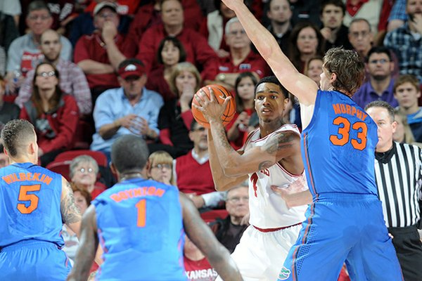 Arkansas' Coty Clarke is surrounded by Florida's defense in the first half of the game Tuesday, Feb. 5, 2013, at Bud Walton Arena in Fayetteville. The Razorbacks upset the Gators, winning 80-69.