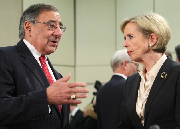 us-secretary-of-defense-leon-panetta-right-talks-with-his-norwegian-counterpart-anne-grete-strom-erichsen-at-the-start-of-a-two-day-nato-defense-ministers-meeting-to-discuss-syria-and-afghanistan-at-nato-headquarters-in-brussels-thursday-feb-21-2013-the-head-of-nato-urged-member-countries-thursday-to-stop-cutting-their-defense-budgets-in-response-to-tough-economic-times-saying-continued-reductions-will-compromise-the-safety-of-all-of-the-military-alliances-28-members