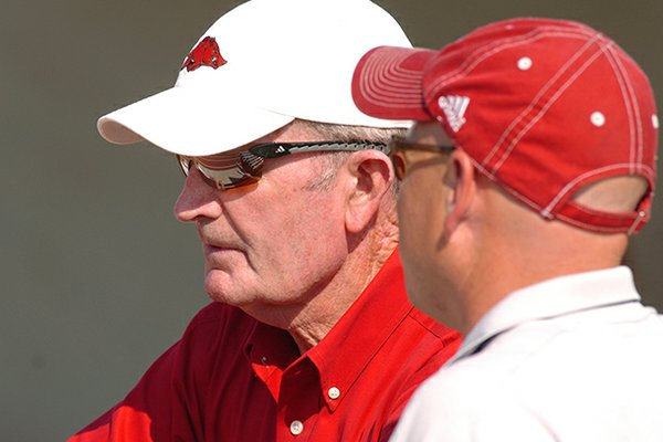 John McDonnell (left) spent 30 years as Arkansas' track & field and cross country coach.