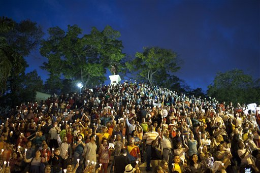 people-hold-up-candles-during-candlelight-vigil-for-venezuelas-president-hugo-chavez-to-pray-for-his-health-as-he-remains-in-a-hospital-undergoing-cancer-treatment-in-caracas-venezuela-friday-feb-22-2013-the-government-has-not-given-details-about-the-treatment-chavez-is-undergoing-and-hasnt-identified-the-type-or-exact-location-of-the-tumors-that-have-been-removed-from-his-pelvic-region