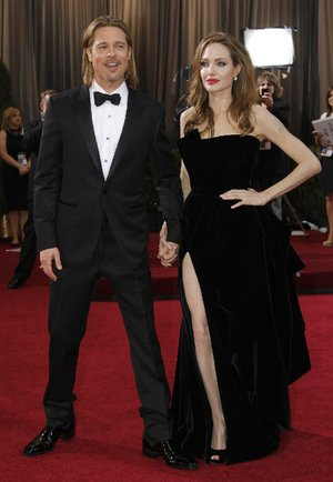 What are they wearing? A-listers Brad Pitt and Angelina Jolie pose before the 2012 Oscars. Jolie's bared leg caused the biggest buzz on the red carpet last year.