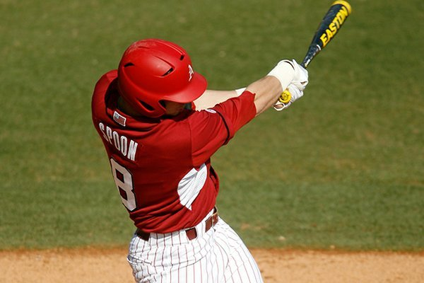 Arkansas' Tyler Spoon follows through on an at-bat against Evansville on Saturday, Feb. 23, 2013, at Baum Stadium in Fayetteville.