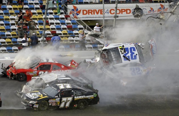 kyle-larson-32-is-airborne-after-a-multi-car-crash-including-parker-kilgerman-77-justin-allgaier-31-and-brian-scott-2-during-the-final-lap-of-the-nascar-nationwide-series-auto-race-at-daytona-international-speedway-saturday-feb-23-2013-in-daytona-beach-fla-larsons-car-collided-with-the-catch-fencing