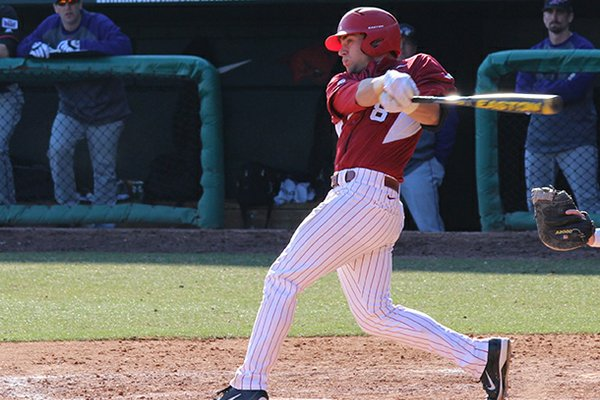 Tyler Spoon hits a grand slam home run during the eighth inning of a game against Evansville on Saturday, Feb. 23, 2013 at Baum Stadium in Fayetteville.