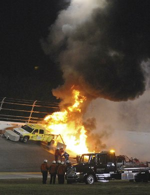 Fuel in a jet dryer burns after Juan Pablo Montoya's car slid sideways and struck it during last year's Daytona 500. The fire stopped the event for two hours as workers put out the fire and then tried to repair the track.