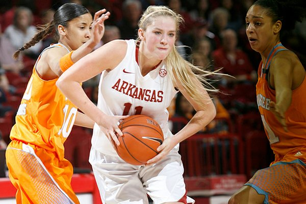 Arkansas sophomore Calli Berna tries to get through Tennessee junior Meighan Simmons (left) and sophomore Cierra Burdick during the second half on Sunday, Feb. 24, 2013, at Bud Walton Arena in Fayetteville.