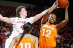 Arkansas senior Sarah Watkins and Tennessee freshman Bashaara Graves vie for a rebound during the second half on Sunday, Feb. 24, 2013, at Bud Walton Arena in Fayetteville.