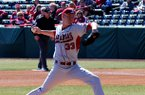 Trey Killian delivers a pitch during Arkansas' 10-2 win over Evansville on Feb. 24, 2012 at Baum Stadium in Fayetteville.
