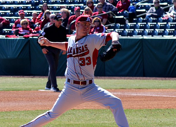 trey-killian-delivers-a-pitch-during-arkansas-10-2-win-over-evansville-on-feb-24-2012-at-baum-stadium-in-fayetteville
