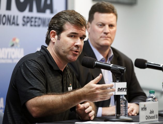daytona-international-speedway-president-joie-chitwood-iii-left-speaks-at-news-conference-with-steve-odonnell-nascar-senior-vice-president-after-numerous-spectators-were-injured-when-driver-kyle-larsons-car-crashed-in-a-catch-fence-on-the-last-lap-of-the-nascar-nationwide-series-auto-race-saturday-feb-23-2013-in-daytona-beach-fla-larsons-crash-sent-car-parts-and-other-debris-flying-into-the-stands