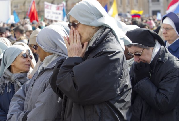 nuns-pray-as-they-wait-for-pope-benedict-xvis-last-angelus-prayer-in-st-peters-square-at-the-vatican-sunday-feb-24-2013-benedict-xvi-gave-his-pontificates-final-sunday-blessing-from-his-studio-window-to-the-cheers-of-tens-of-thousands-of-people-packing-st-peters-square-but-sought-to-reassure-the-faithful-that-he-wasnt-abandoning-the-church-by-retiring-to-spend-his-final-years-in-prayer-the-85-year-old-benedict-is-stepping-down-on-thursday-evening-the-first-pope-to-do-so-in-600-years-after-saying-he-no-longer-has-the-mental-or-physical-strength-to-vigorously-lead-the-worlds-12-billion-catholics
