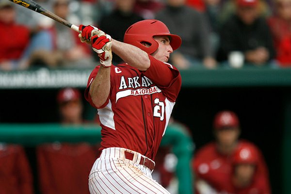 Arkansas' Matt Vinson follows through on an at-bat against Evansville on Saturday, Feb. 23, 2013, at Baum Stadium in Fayetteville.