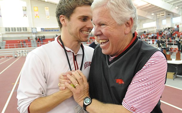 Arkansas women's track and field coach Lance Harter, right, is congratulated by men's manager Georg Eberhardt after winning the conference title Sunday, Feb. 24, 2013, during the Southeastern Conference Indoor Track and Field Championships at the Randal Tyson Track Center in Fayetteville.