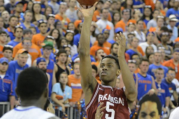 Arkansas guard Anthlon Bell (5) shoots for the basket as Florida's Casey Prather (24) watches during the second half of an NCAA college basketball game in Gainesville, Fla., Saturday, Feb. 23, 2013. Florida won 71-54. (AP Photo/Phil Sandlin)