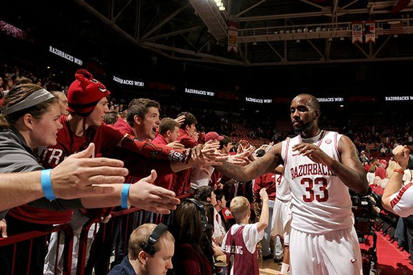 Arkansas junior Marshawn Powell (33) celebrates with fans after defeating Georgia Thursday, Feb. 21, 2013 at Bud Walton Arena in Fayetteville. The Razorbacks won 62-60.