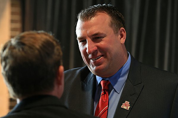 Razorback football coach Bret Bielema greets fans before a Razorback Day at the Capitol lunch in Little Rock.