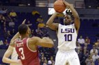 LSU's Andre Stringer (10) shoots a 3-pointer against Arkansas' Rickey Scott (3) during their NCAA college basketball game, Wednesday, Feb. 27, 2013, in Baton Rouge, La. (AP Photo/The Advocate, Heather McClelland)