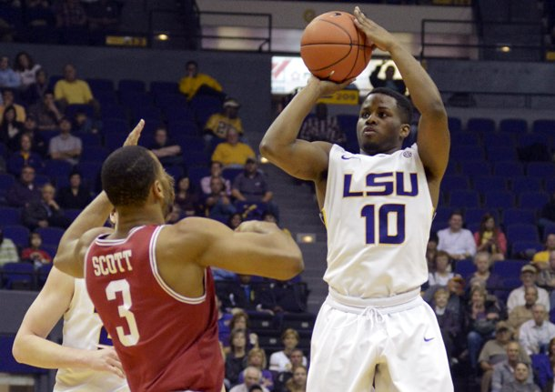 lsus-andre-stringer-10-shoots-a-3-pointer-against-arkansas-rickey-scott-3-during-their-ncaa-college-basketball-game-wednesday-feb-27-2013-in-baton-rouge-la-ap-photothe-advocate-heather-mcclelland