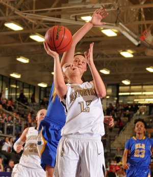 Bentonville's Taylor Lee tries to drive past North Little Rock defender Halley Hill during Thursday's girls 7A State Basketball Tournament in Fayetteville.